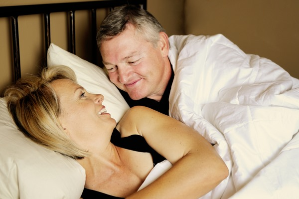 happy-couple-in-bed-after-sex